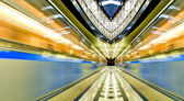 Vivid symmetric illuminated metro station with marble floor — Stock Photo