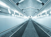 Fast moving trains on underground platform — Stock Photo