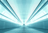Symmetric moving blue escalator inside contemporary airport — Stock Photo