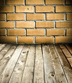Red brick wall and wooden floor, rural interior — Stock Photo