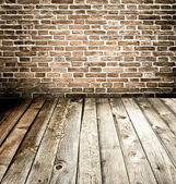 Abstract brick wall and wood floor — Stockfoto