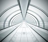 Black symmetric vanishing corridor with bent wall — Stock Photo