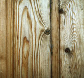 Close-up of fragment of wooden surface of brown color with visible texture — Stock Photo