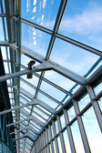 Structure of modern glass limpid ceiling inside shopping mall — Stock Photo