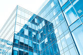 Low angle view to light glass buildings of business center — Stock Photo