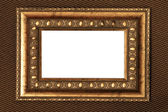 Vintage metal frame with white background over fabric texture — Stock Photo