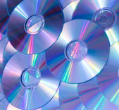 Violet background of compact discs — 图库照片