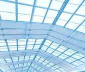 Blue transparent ceiling inside contemporary airport — Stock Photo