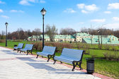 White benches in summer park — Stock Photo