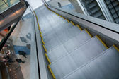 Gray steps of escalator in business center — Stock Photo