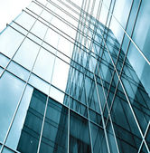 Block with real estate of glass skyscraper perspective view — Stock Photo