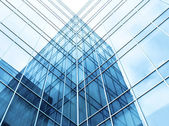 Transparent glass wall of office building — Stock Photo