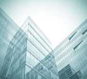 Business background of glass and metallic modern architecture in — Photo