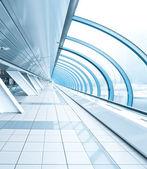 Wide spacious corridor in contemporary airport walkway — Stock Photo