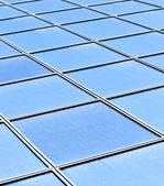 Contemporary striped blue texture of glass architecture — Stock Photo