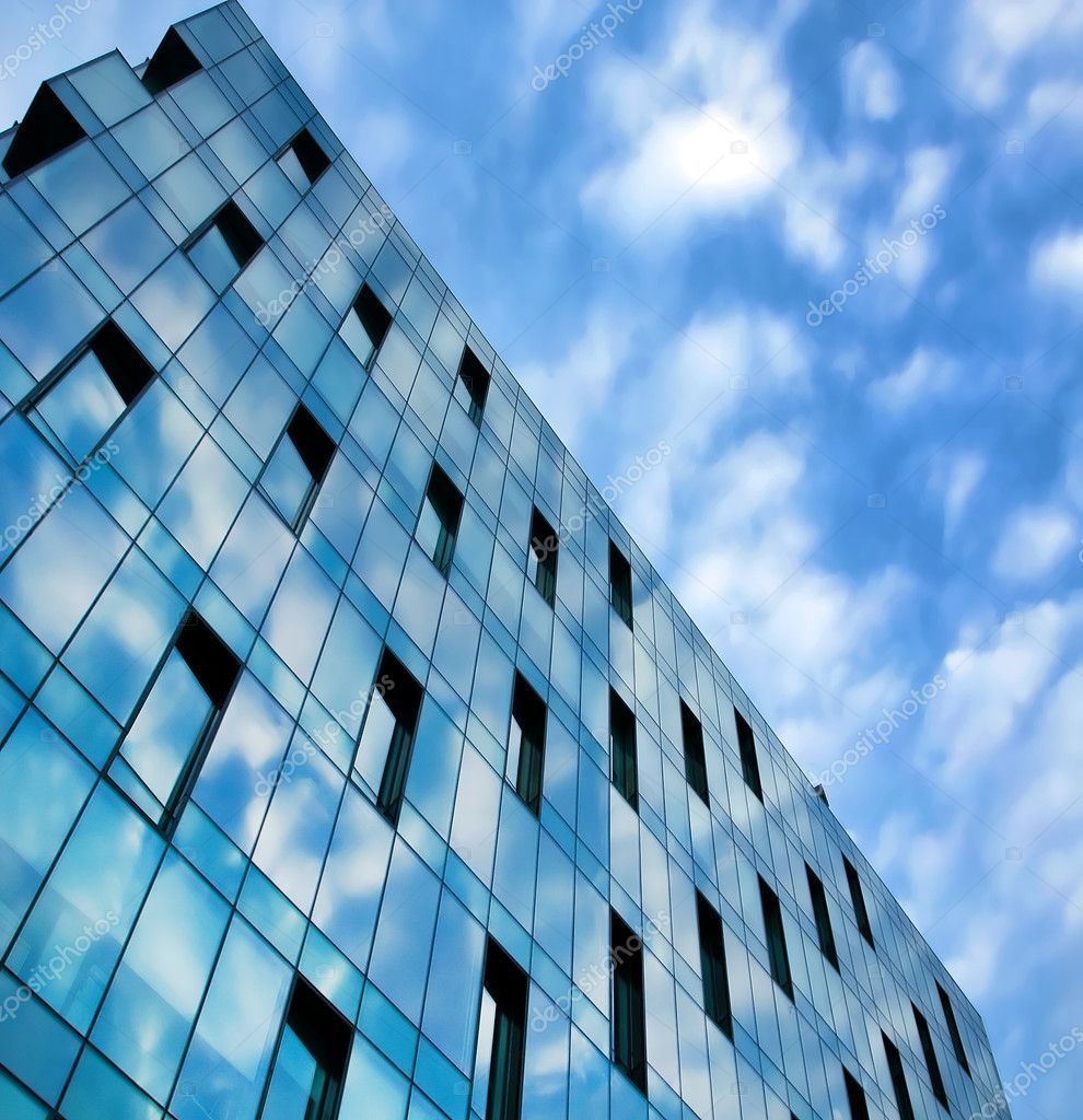 Modern glass side of office building in business center for Modern business buildings