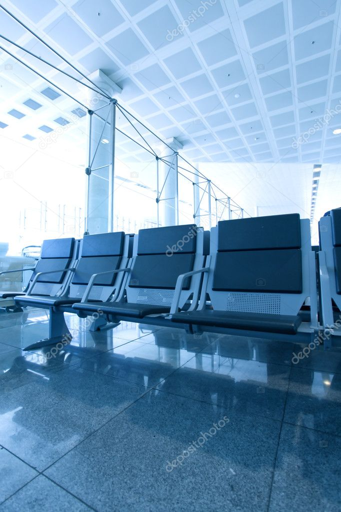 Contemporary blue lounge with seats in the airport  Stock Photo #6713678