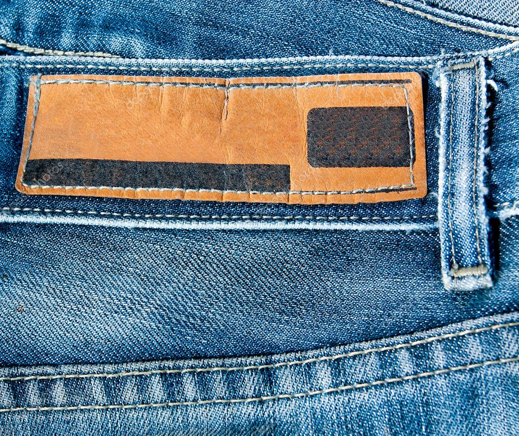 Blue jeans with blank leather label — Stock Photo