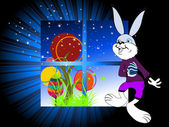 Night background with bunny holding egg — Stock Vector