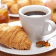 Breakfast with coffee and croissant — Stock Photo #6114527