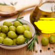 Green olives and oil — Stock Photo #6114539