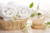 Towels flowers and massage brush — Stock Photo
