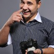 Funny man with a digital camera - Stock Photo
