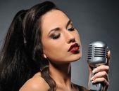 Beautiful brunette woman singing — Stock Photo