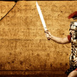 Royalty-Free Stock Photo: Roman legionary soldier in front of abstract wall