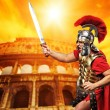Roman legionary soldier in front of coliseum — Stock Photo #5517881