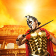 Stock Photo: Roman legionary soldier in front of coliseum