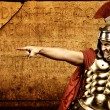 Legionary soldier in front of roman wall — Stock Photo #5517889