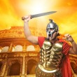 Royalty-Free Stock Photo: Roman legionary soldier in front of coliseum