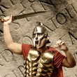 Stock Photo: Roman legionary soldier in front of abstract wall
