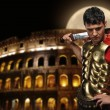 Roman legionary soldier in front of coliseum at night time — Stock Photo #5518028