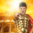 Angry roman legionary soldier in front of coliseum — Stock Photo #5518035