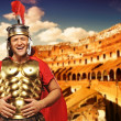 Roman legionary soldier in front of coliseum — Stock Photo #5518082