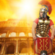 Roman legionary soldier in front of coliseum — Stock Photo #5518092