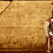 Roman legionary soldier in front of abstract wall — Stock Photo #5518103