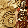 Roman legionary soldier in front of abstract wall — Stock Photo