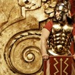 Roman legionary soldier in front of abstract wall — Stock Photo #5518142