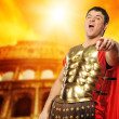 Stock Photo: Legionary soldier in front of coliseum