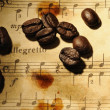 Coffee beans on a grungy musical background — Stock Photo