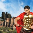 Stock Photo: Roman legionary soldier in front old city of Rome