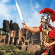 Roman legionary soldier in front old city of Rome - ストック写真