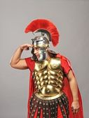 Legionary soldier looking for an enemy — Stock Photo