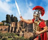 Roman legionary soldier in front old city of Rome — Stock Photo