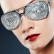 Close-up portrait of a beautiful woman in stylish glasses — Stock Photo