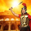 Roman legionary soldier in front of coliseum — Stock Photo #5785771