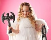 Beautiful little angel with an axe — Stock Photo